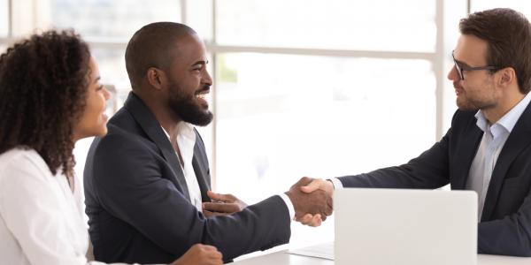 Insurance broker finalizing business deal